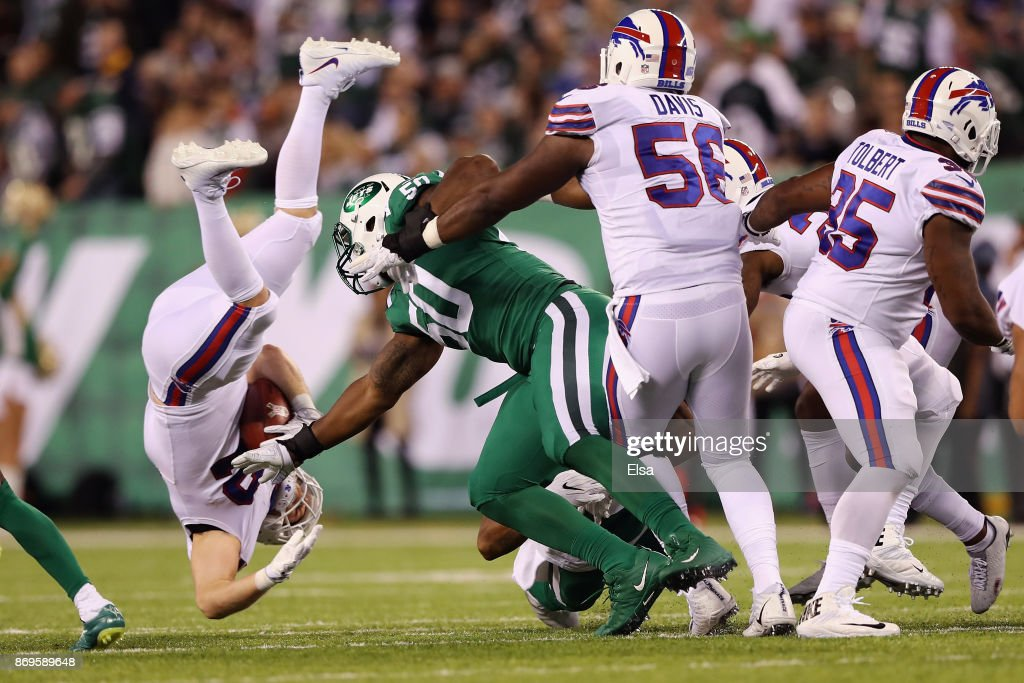 Fullback Patrick DiMarco #42 of the Buffalo Bills is upended by outside linebacker Freddie Bishop #50 of the New York Jets during the second half of the game at MetLife Stadium on November 2, 2017 in East Rutherford, New Jersey.