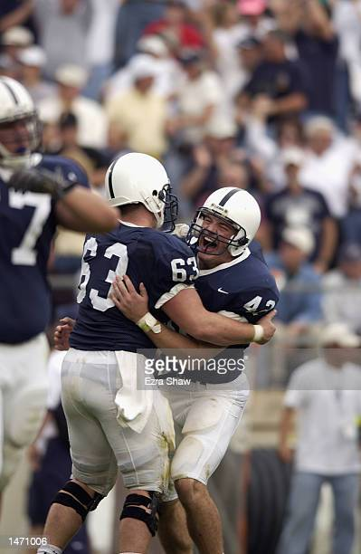 Fullback Sean McHugh and center Joe Iorio of the Penn State Nittany Lions celebrate a touchdown during the Big Ten Conference football game against...