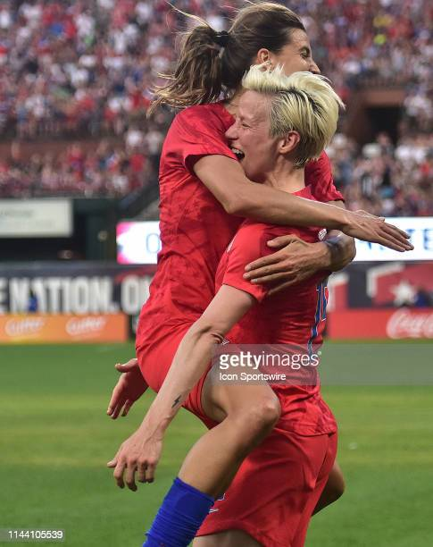 USA fullback Tobin Heath jumps into celebrates with USA fullback Megan Rapinoe after scoring a goal during a soccer game between the US Women's...
