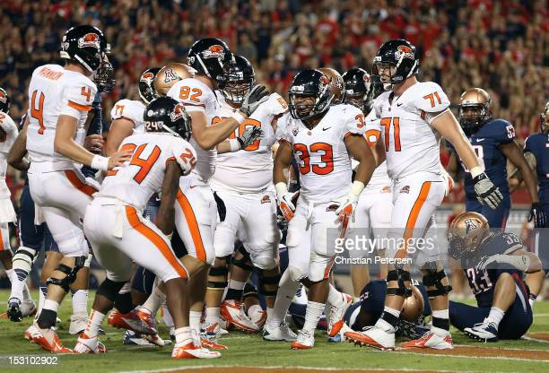 Fullback Tyler Anderson of the Oregon State Beavers celebrates with teammates after scoring a 1 yard rushing touchdown against the Arizona Wildcats...