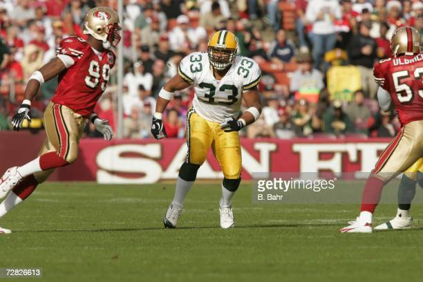 Fullback William Henderson of the Green Bay Packers blocks against linebacker Manny Lawson of the San Francisco 49ers on December 10 2006 at Monster...