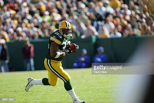 Fullback William Henderson of the Green Bay Packers carries the ball against the New Orleans Saints at Lambeau Field on October 9 2005 in Green Bay...