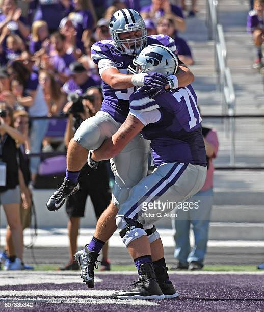 Fullback Winston Dimel of the Kansas State Wildcats celebrates with teammate Dalton Risner after scoring a touchdown against the Florida Atlantic...