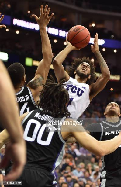 Fuller of the TCU Horned Frogs shoots against Levi Stockard III and Mike McGuirl of the Kansas State Wildcats in the second half during the first...