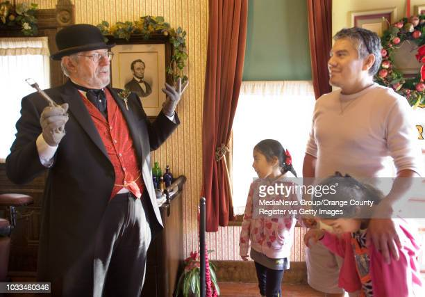 Fullerton Arboretum docent Jack Reynolds talks to visitors at the Doctor George Crook Clark home about what medicine was like the Victorian era...