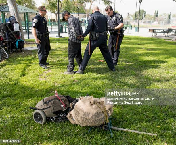 Fullerton Police officers handcuff a man in a park that had a meth pipe in his possession in Fullerton on Thursday February 16 2017 With each...