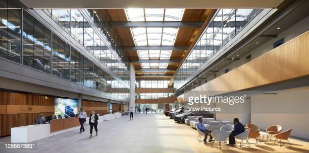 Full-height atrium with skylight roof and main entrance reception. Jaguar Land Rover, Gaydon, United Kingdom. Architect: Bennetts Associates...
