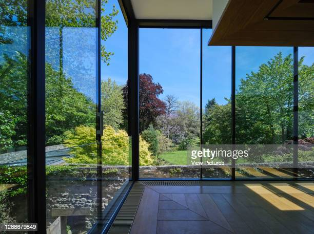 Full-height glazing in seminar room with view towards The Groves. Study Centre at St John's College Library, Oxford, United Kingdom. Architect:...