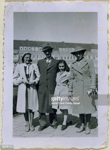 Fulllength family portrait of Margot Otto Anne and Edith Frank at the Merwedeplein taken from Anne's photo album Amsterdam Holland 1941