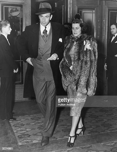 Full-length image of American actor Gary Cooper and his wife, actor Sandra Shaw , arriving at a preview of director WS Van Dyke's film, 'Rosalie'....