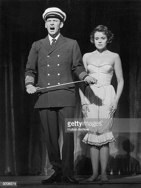 Fulllength image of American actor Tony Randall and singer Jacqueline McKeever performing on stage in a scene from the play 'Oh Captain' at the Alum...