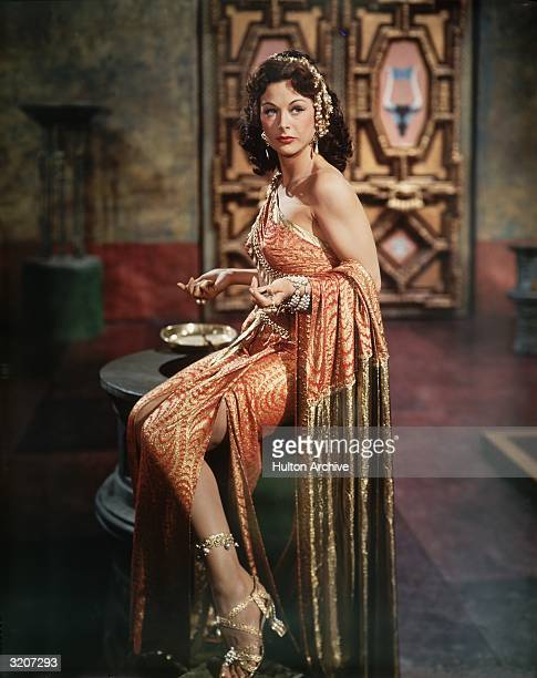 Fulllength image of Austrianborn actor Hedy Lamarr wearing an ornamental costume as the character Delilah in a still from director Cecil B DeMille's...