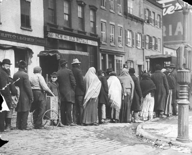 Full-length image of people queuing up to buy coal...