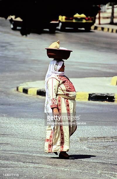 Fulllength portrait of a woman walking in the street Amman Jordan
