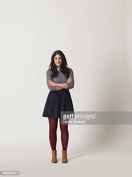 full-length portrait of a young woman - black skirt stock pictures, royalty-free photos & images