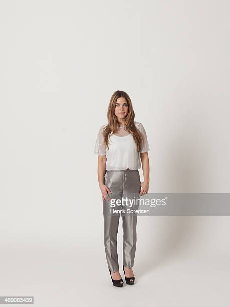 full-length portrait of a young woman - gray pants stock pictures, royalty-free photos & images