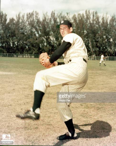 Fulllength portrait of American professional baseball player Don Larsen posed in a pitching stance as a player for the New York Yankees c 1957