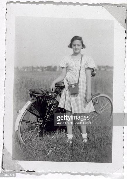 Fulllength portrait of Anne Frank's sister Margot standing next to her bicycle Netherlands September 1938 Taken from Anne Frank's photo album