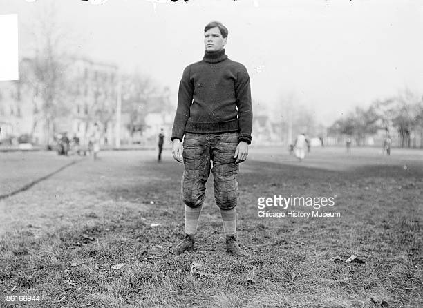 Full-length portrait of B. H. Badenoch, University of Chicago football team captain, standing on a field in the Hyde Park community area of Chicago,...