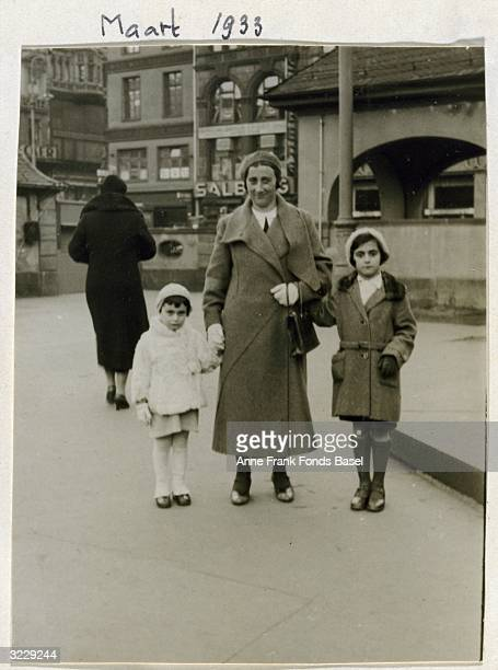 Fulllength portrait of Edith Frank with her daughters Anne and Margot in downtown Frankfurt am Main Germany Taken from Anne Frank's photo album