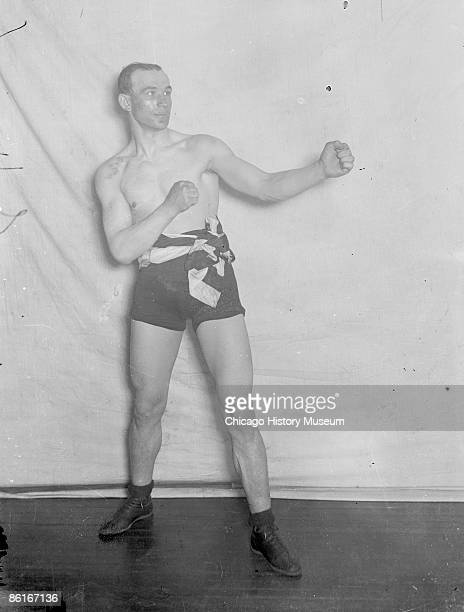 Fulllength portrait of light heavyweight boxing champion Jack Root facing right with head pulled back standing in upright ordinary boxing stance in...