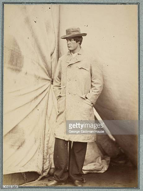 Fulllength portrait of Lincoln assassination conspirator Lewis Payne born Lewis Powell standing in front of a tent with one hand in the pocket of his...