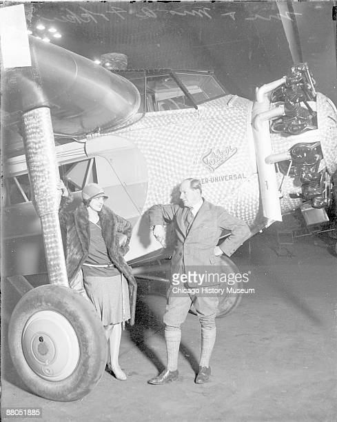 Fulllength portrait of Mr and Mrs Anthony Fokker standing in front of a Fokker airplane in a hangar in Chicago Illinois 1928 From the Chicago Daily...