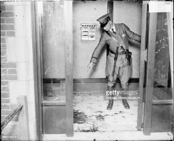 Fulllength portrait of policeman Howard Anderson of the Chicago Police Department standing in the small lobby of a building in Chicago Illinois scene...
