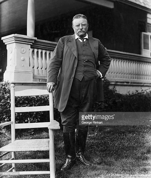 Fulllength portrait of President Theodore Roosevelt standing beside a chair outside wearing equestrian attire Photo circa 1907