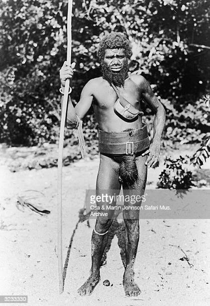 Fulllength portrait of Rombe the brother of Nagapate the Chief of the Big Nambas wearing a nose ring a penis sheath and carrying a spear New Hebrides