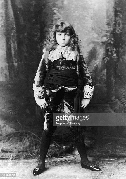 Fulllength portrait of seven year old child actor Elsie Leslie in costume for her role as the title character of the play 'Little Lord Fauntleroy'...