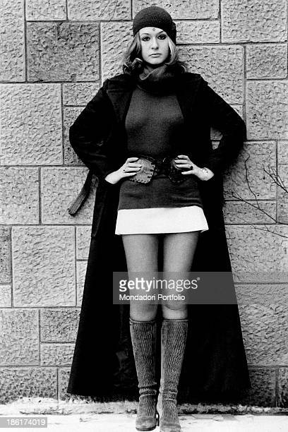 Fulllength portrait of the Italian singer actress presenter showgirl and first female impersonator of the Italian television Loretta Goggi with a...