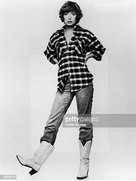 Fulllength promotional studio portrait of American actor Penny Marshall wearing cowboy boots 1970s