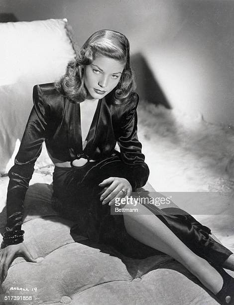 Fulllength publicity portrait of actress Lauren Bacall She is shown seated on a chaise lounge Photo 1945
