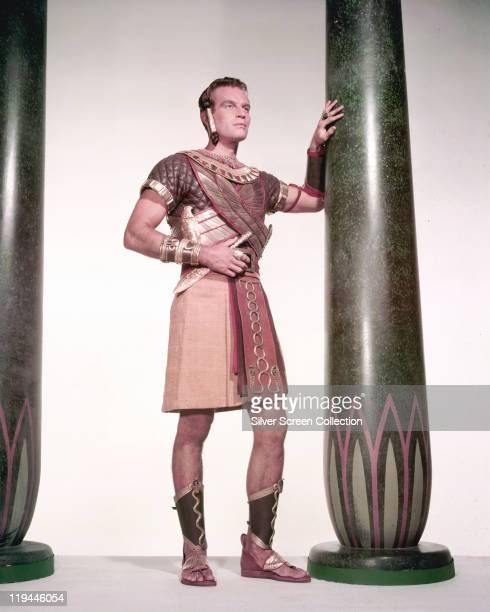 Full-length shot of Charlton Heston , US actor, in costume as he leans against a pillar in a publicity portrait issued for the film, 'The Ten...