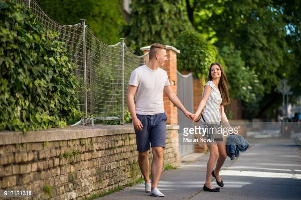 Full-length shot of young couple outdoors in city