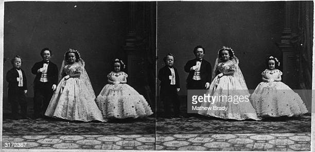 Fulllength stereoscope portrait of Charles 'General Tom Thumb' Stratton and his bride Lavinia Warren posing on their wedding day in Grace Church New...