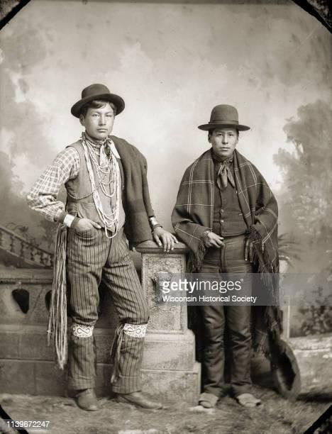 Fulllength studio portrait of HoChunk men Frank GreencloudRedcloud left and Ed Greengrass Black River Falls Wisconsin 1888 Frank GreencloudRedcloud...