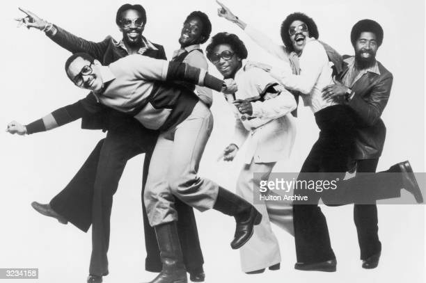 Fulllength studio portrait of the American RB and funk group the Commodores striking a pose of moving in a forward direction Lead singer Lionel...