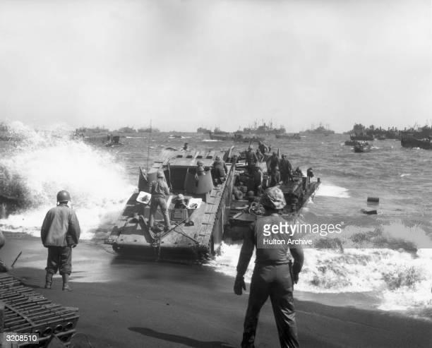 Full-length view of Amphibious Corps landing craft operations on Yellow Beach, Iwo Jima, Japan, World War II.
