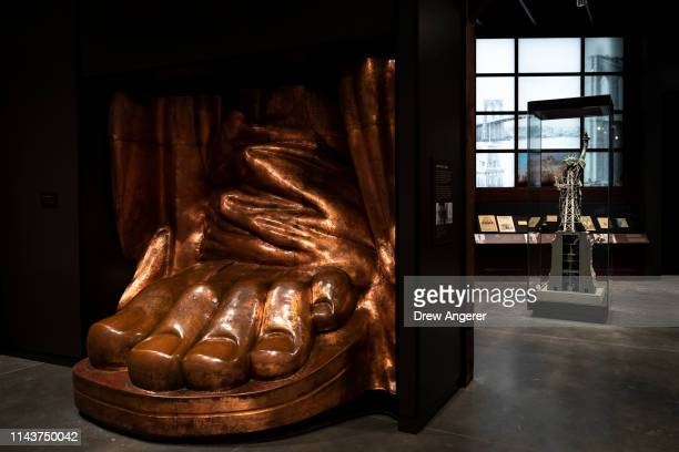 A fullscale copper model of the Statue of Libertys foot created in 1986 is on display during a tour of the new Statue of Liberty Museum May 13 2019...