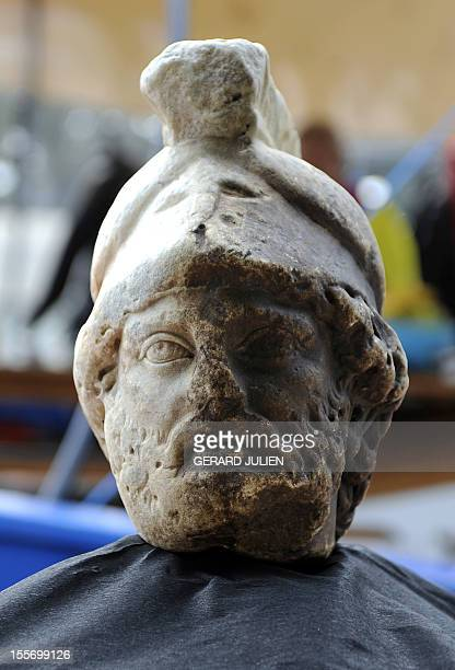 A fullscale marble head of the Roman god Mars found during the last archaeological digs in the Rhone river in Arles southern France sits on the bank...