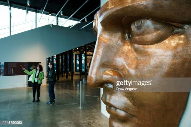 A fullscale replica of the face of the Statue of Liberty is on display during a tour of the new Statue of Liberty Museum May 13 2019 on Liberty...