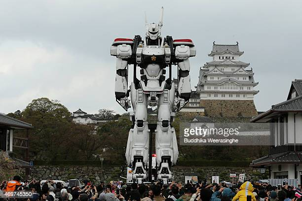 A fullsize model of the animation character Patlabor AV98 Ingram stands at front of the World Heritage Himeji castle as people look on April 15 2015...