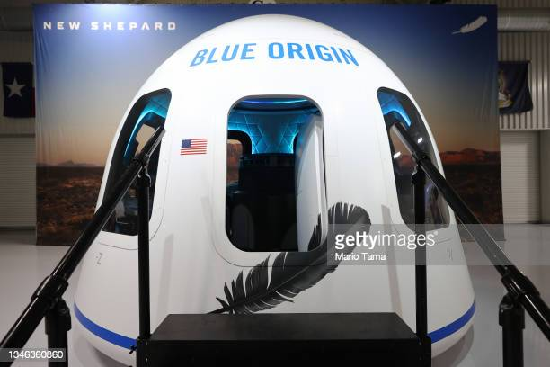 Full-size replica of Blue Origin's crew capsule is displayed before Blue Origin's New Shepard lifts-off from the launch pad carrying 90-year-old Star...