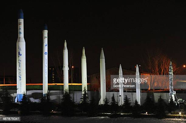 Fullsize replicas of each of Iran's space rockets and ballistic missiles are displayed at night on the grounds of the Museum of Holy Defense and...