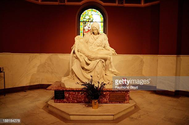 A fullsized replica of Michaelangelo's Pieta sits in the basement inside of Basilica Of Our Lady Of Sorrows in Chicago Illinois on OCTOBER 17 2011