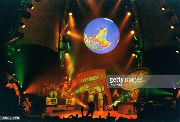 A fullstage view of Oasis performing on stage at The National Indoor Arena during the 'Be Here Now' tour on September 30th 1997 in Birmingham England