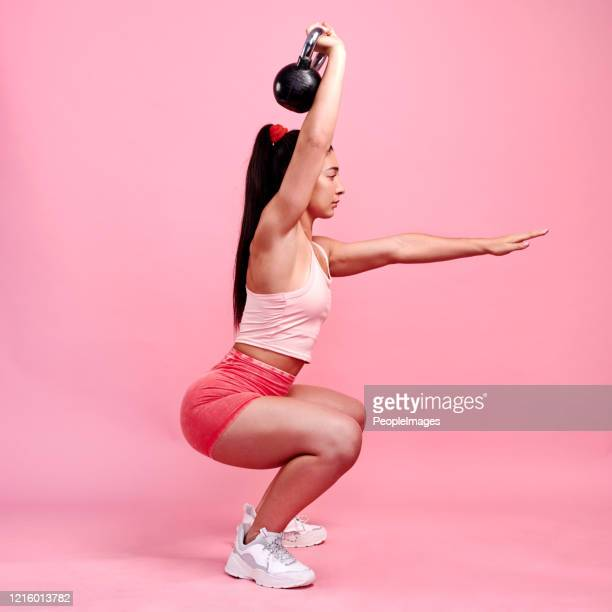fully focused on her form - running shorts stock pictures, royalty-free photos & images