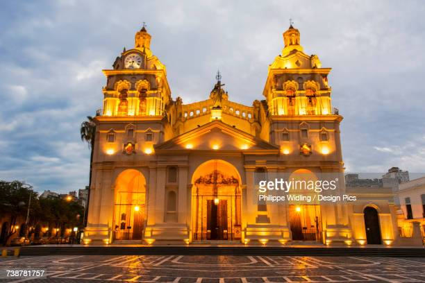 Fully lit South American church and plaza at dusk